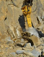 Atlas Copco HB 3100 hydraulic breaker in direct mining application